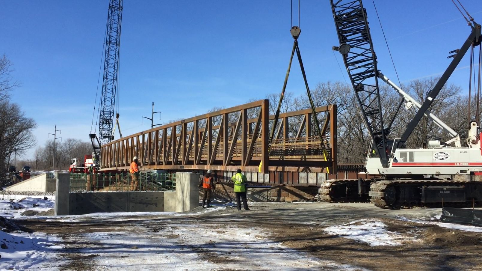 Crews install the bridge across the Sauk River at Waite Park's River's Edge Park on February 16, 2018  -Stearns County Parks photo